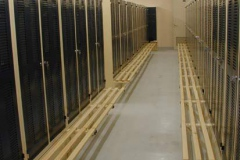 Furnished with twin compartments lockers, secured on floor, punched doors and hanging benches secured on the frame